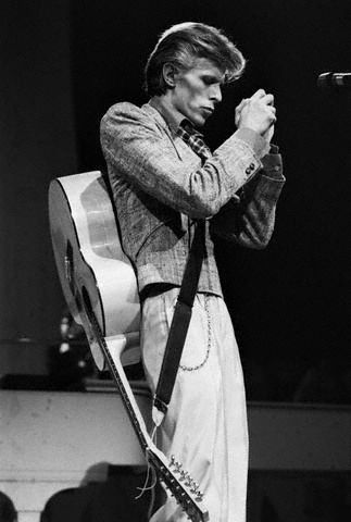 David Bowie with Guitar on Back