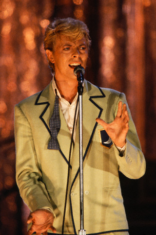 David Bowie in Green Suit, Singing